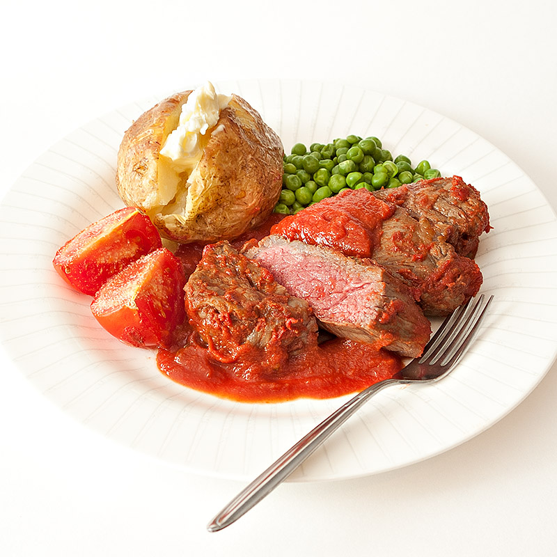 Steak Marinated in a Tomato and Herb Sauce